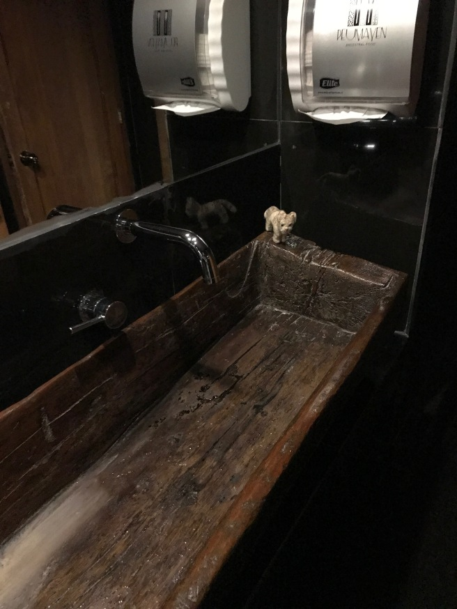 Frankie inspected the wooden sink