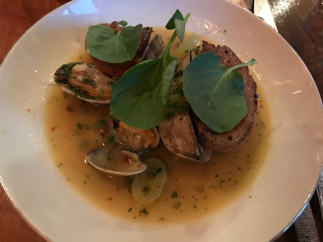 Spicy Manila clams, onions, peppers, guanciale, preserved lemon butter, watercress