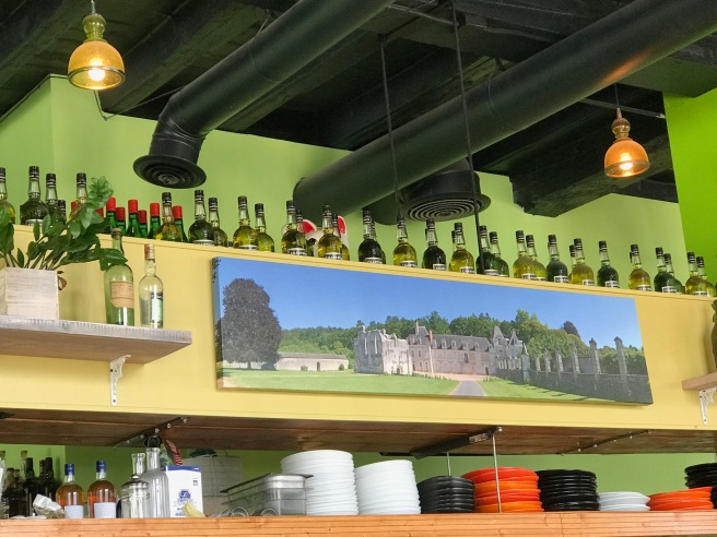 bottles of Chartreuse above the bar