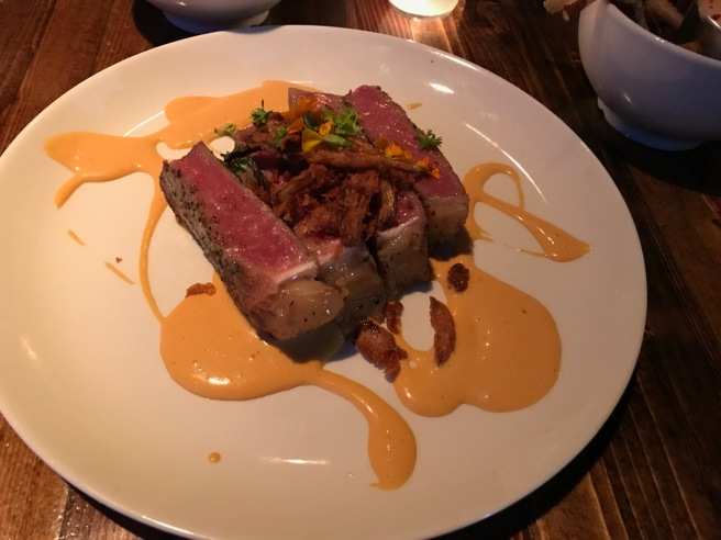 dry aged New York strip with steak sauce hollandaise