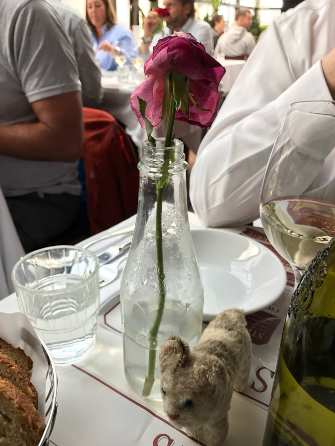 Frankie checked out the table flower