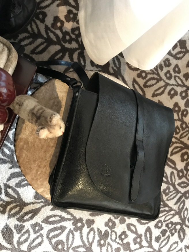 Frankie checked out the purse stool
