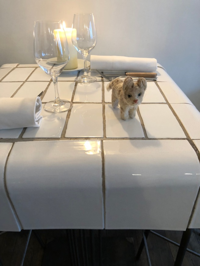 Frankie checked out the tables in the bar