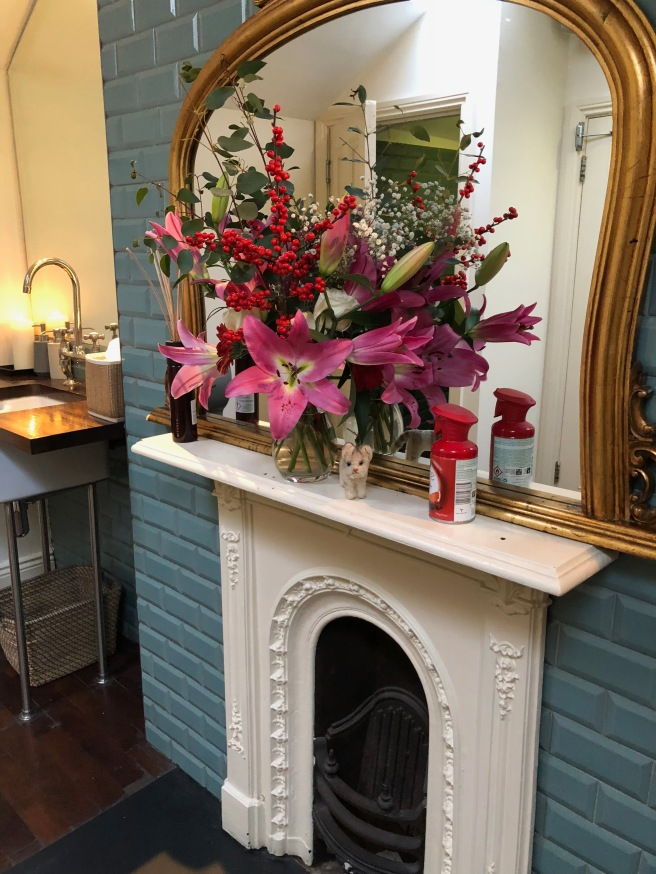 Frankie found flowers and a fireplace in the bathroom