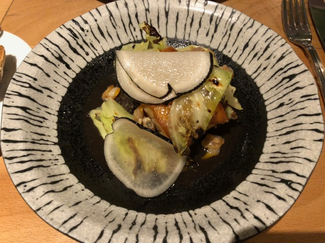 Glazed cod, mushroom dashi, hispi cabbage and pickled cockles