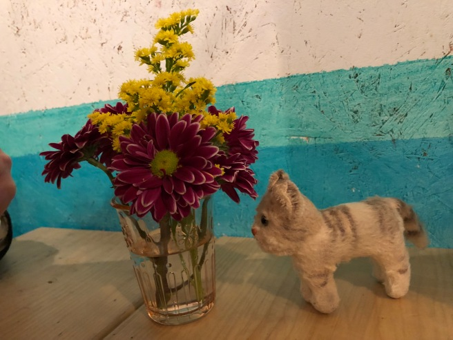 Frankie sniffed the table flowers