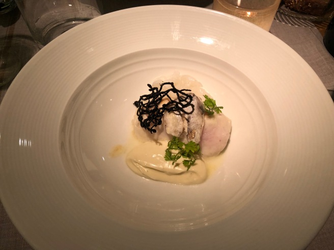 "Hake Pilpill (light garlic sauce, ""cococha"" and cuttlefish noodles"