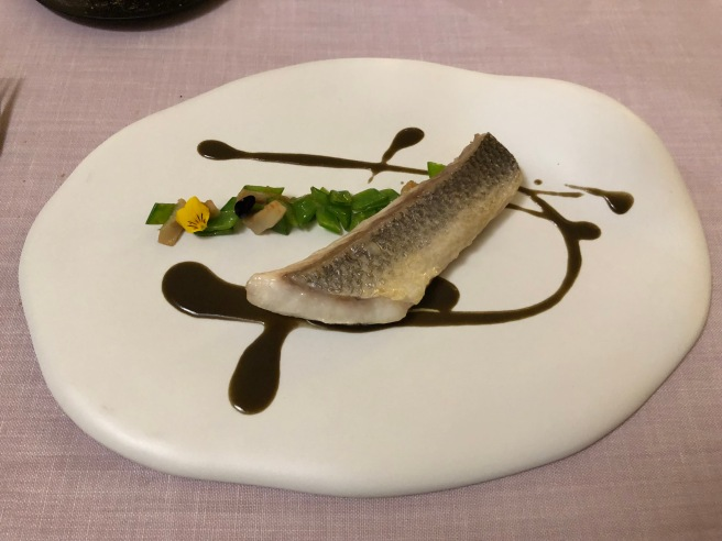 Sea bass, snow peas, pork dewlap and squid ink