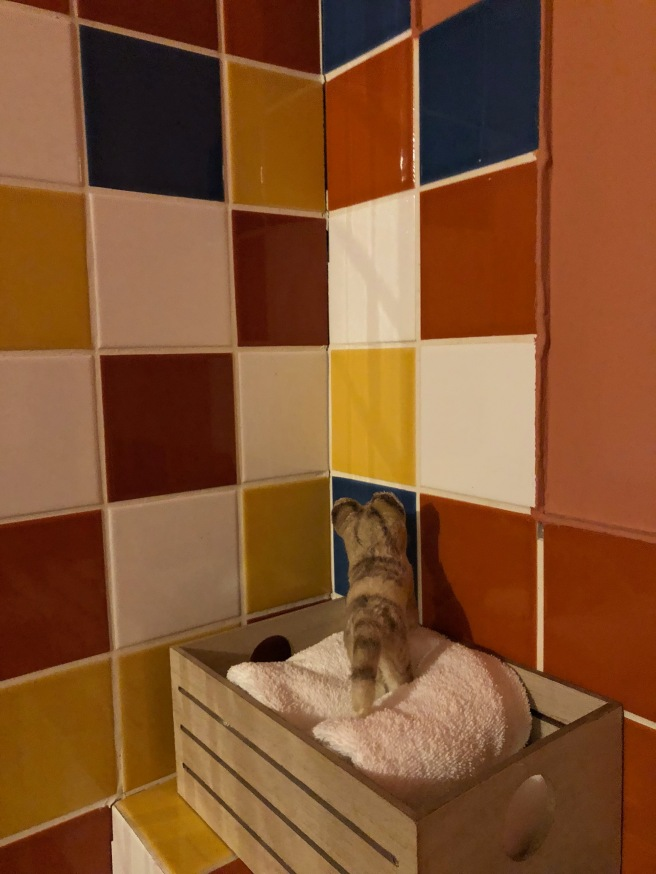 Frankie studied the colorful tiles
