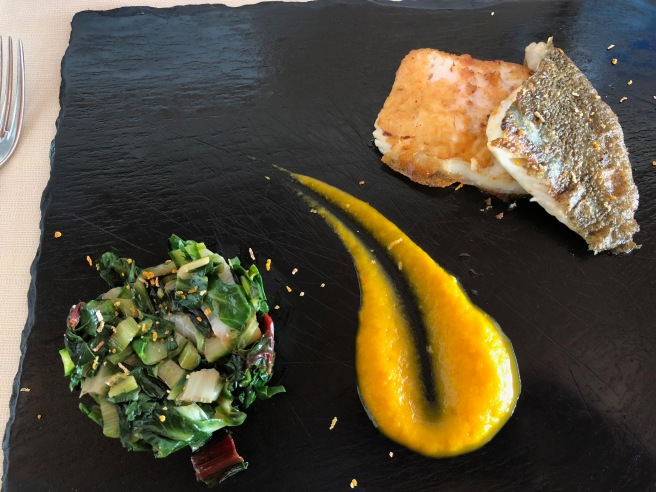 Grilled turbot fillet served on field cooked salad, carrots and ginger cream