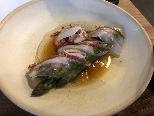 green asparagus, egg yolk and cured Mangalitsa