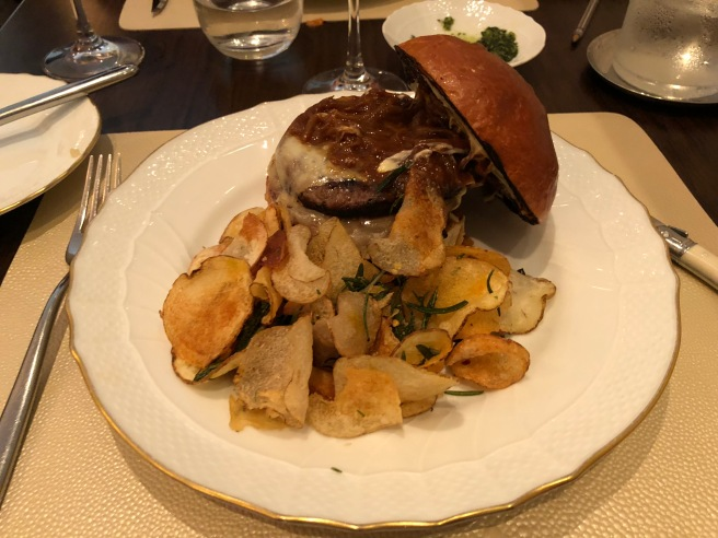 Fusco Burger: aged beef, caramelized onion mostarda and melted fontina
