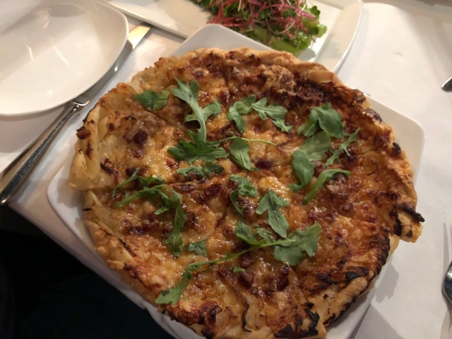 Tarte Flambée with smoked bacon, onion, fromage blanc and Gruyere