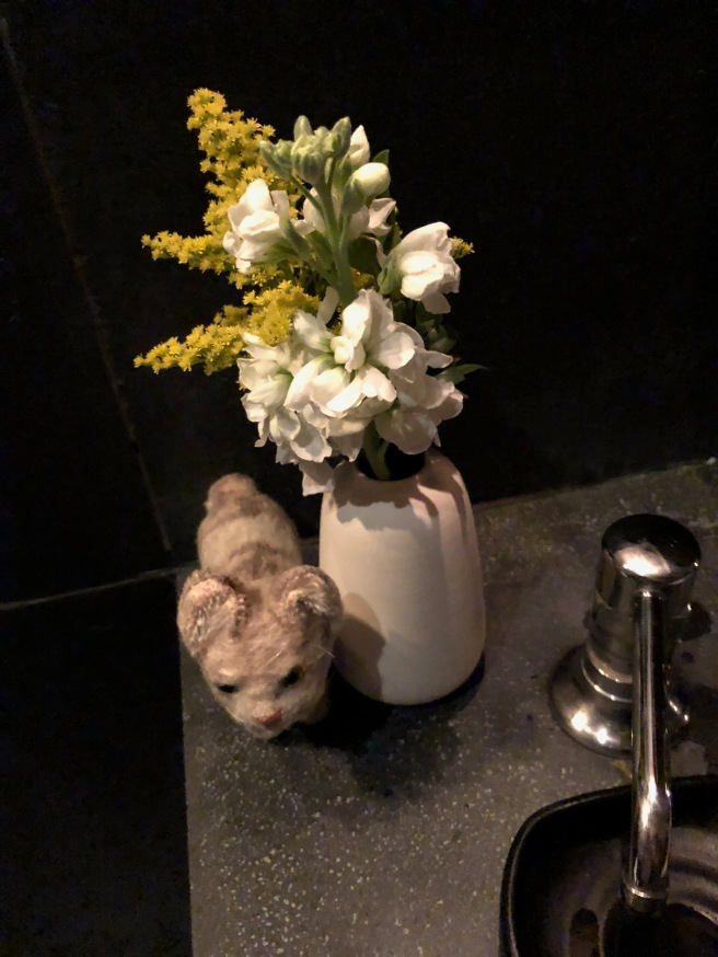 Frankie posed with the bathroom flowers
