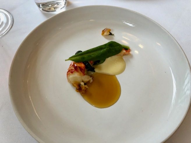 Lobster Butter-Poached with Ginger and Dandelion Greens