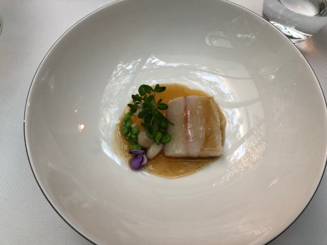 Wild Sea Bass, young vegetables, Majecstic oyster, poultry and cockles jus