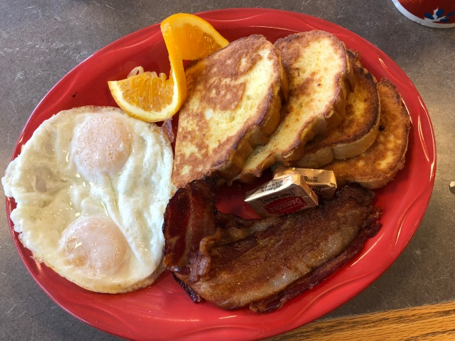 French toast, bacon and eggs