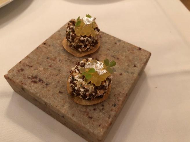 amuse - white char caviar with potato and dark bread