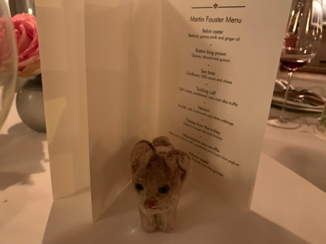 Frankie posed with the menu at the table
