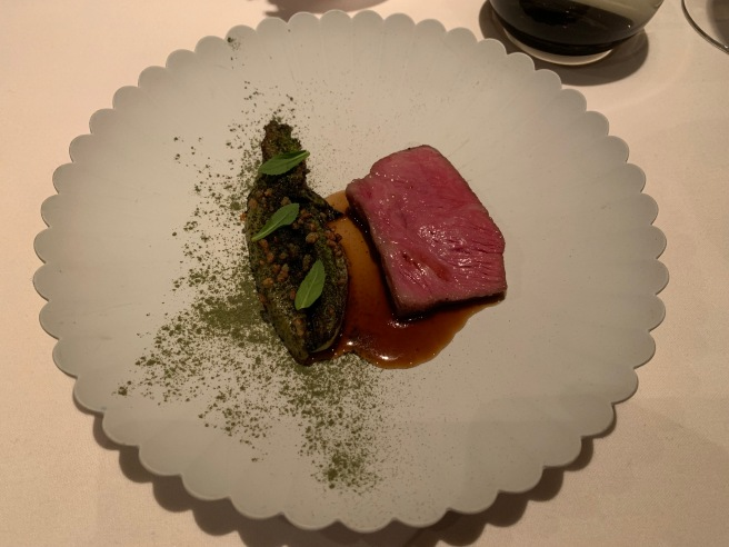 Japamese A5 Wagyu. grilled little gem, shiso and genmai