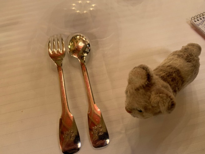 Frankie noticed the initials on the flatware