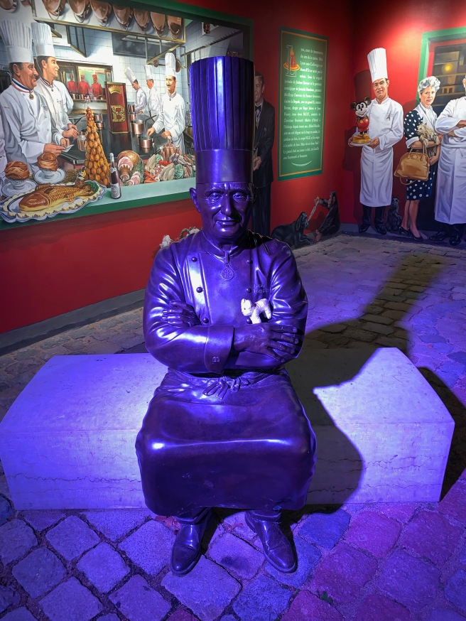 Frankie with a statue of Bocuse, Lyon