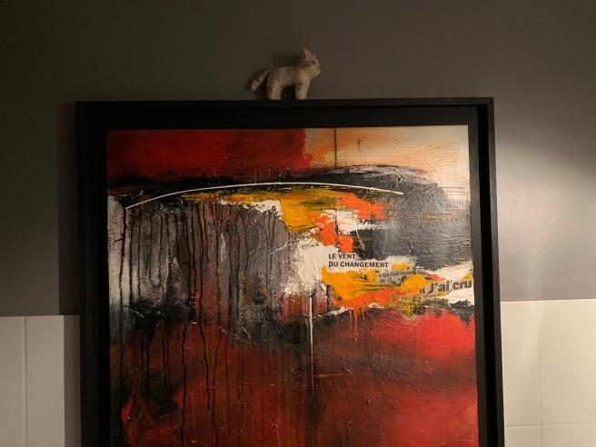 Frankie posed on some art