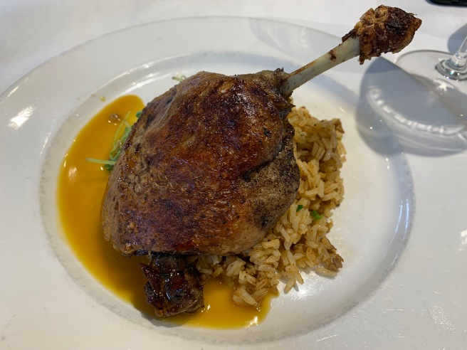 Muscovy Duck Leg Confit, dirty rice and citrus gastrique