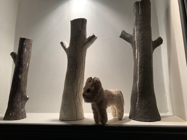 Frankie wondered around the fake trees