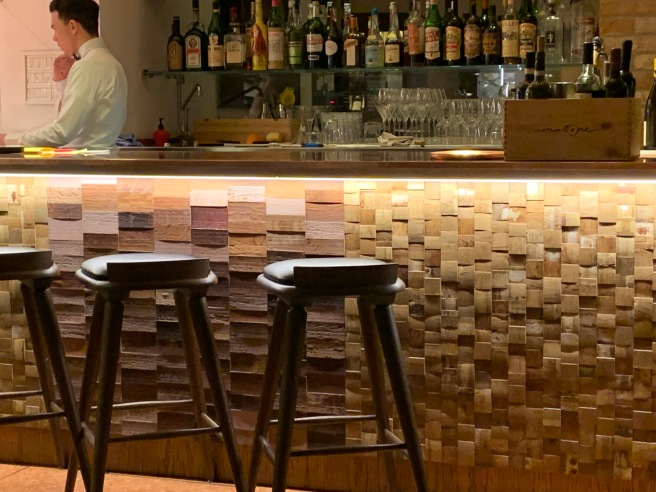 front of bar