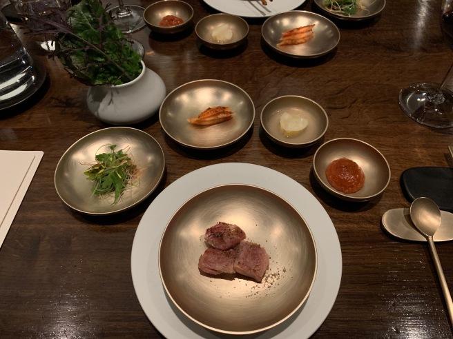 Veal short rib. chrysanthemum-scallion salad, kohlrabi kkakdugi, pear kimchi, tomato meju and lettuces
